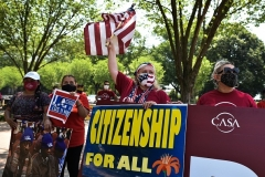 Immigrant advocacy groups rally outside the White House on May 26, 2021, demandding that the Biden administration take action on citizenship for all. (Photo by MANDEL NGAN/AFP via Getty Images)
