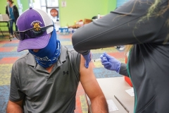 A man gets his COVID vaccination in Pasadena, Texas. (Photo by CECILE CLOCHERET/AFP via Getty Images)
