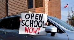 """A rally to """"Open Schools Now"""" in Los Angeles on February 15, 2021. (Photo by FREDERIC J. BROWN/AFP via Getty Images)"""