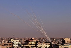 Rockets are launched towards Israel from Rafah in the southern Gaza Strip early Wednesday morning. (Photo by Said Khatib/AFP via Getty Images)