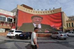 A giant screen beams images of Chinese President Xi Jinping, in the city of Kashgar, Xinjiang, in June 2019.  (Photo by Greg Baker/AFP/Getty Images)