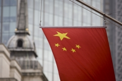 The Chinese national flag hangs from the Bank of China's offices in the City of London, England UK. (Photo credit: In Pictures Ltd./Corbis via Getty Images)
