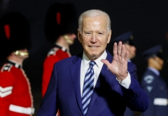 President Joe Biden waves on arrival at Cornwall Airport Newquay, near Newquay, Cornwall, on June 9, 2021. (Photo by PHIL NOBLE/POOL/AFP via Getty Images)
