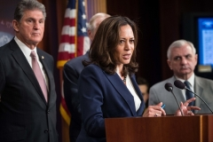 Kamala Harris, now the vice president, joins Sen. Joe Manchin (D-W.Va.) at a press conference in 2018. (Photo by NICHOLAS KAMM/AFP via Getty Images)