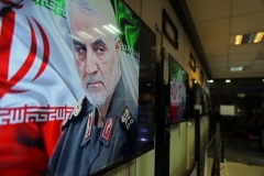 An image of Qassem Soleimani is seen on a television set in a Tehran store two days after he was killed in a U.S. drone strike in Baghdad last January. (Photo by Majid Saeedi/Getty Images)