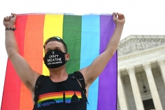 Featured is a protester for gay pride and Black Lives Matter. (Photo credit: JIM WATSON/AFP via Getty Images)