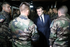 President Emmanuel Macron meets with French troops in West Africa in 2019. (Photo by Ludovic Marin/AFP via Getty Images)