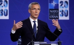 NATO Secretary-General Jens Stoltenberg addresses a press conference in Brussels on Monday night. (Photo by Olivier Hoslet/Pool/AFP via Getty Images)