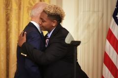 President Joe Biden embraces 16-year-old transgender activist Ashton Mota during a White House Pride event on June 25. (Photo by Chip Somodevilla/Getty Images)