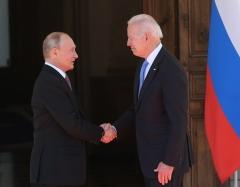 Russian President Vladimir Putin shakes hands with President Joe Biden on June 16, 2021 in Geneva, Switzerland. (Photo by Mikhail Svetlov/Getty Images)