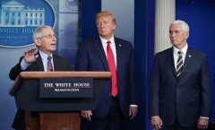 Director of the National Institute of Allergy and Infectious Diseases Anthony Fauci, flanked by  President Donald Trump and Vice President Mike Pence, speaks during the daily briefing on the novel coronavirus on April 22, 2020. (Photo by MANDEL NGAN/AFP via Getty Images)