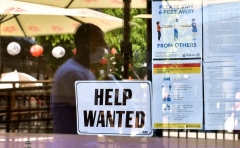 A 'Help Wanted' sign is posted beside coronavirus safety guidelines in front of a restaurant in Los Angeles, California on May 28, 2021. (Photo by FREDERIC J. BROWN/AFP via Getty Images)