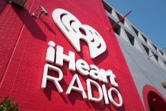Featured is a sign for iHeartRadio music radio, part of the iHeartMedia company, at the company's local headquarters in the South of Market (SoMa) neighborhood of San Francisco, Calif. (Photo credit: Smith Collection/Gado/Getty Images)