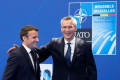 French President Emmanuel Macron greets NATO secretary-general Jens Stoltenberg at Monday's summit in Brussels. (Photo by Francois Mori / Pool/AFP via Getty Images)