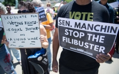 Activists rally on June 23, 2021, urging senators, specifically Senator Joe Manchin (D-W.Va.), to eliminate the Senate filibuster so Democrats can pass their entire leftist agenda without a single Republican vote. (Photo by SAUL LOEB/AFP via Getty Images)