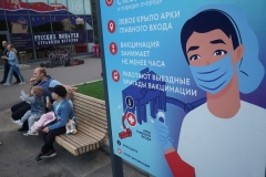 A poster in a Moscow park promotes COVID-19 vaccination. (Photo by Mikhail Svetlov/Getty Images)
