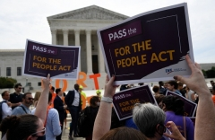 Democrats and their allies are hellbent on passing a voting bill that would relax safeguards, including voter ID, making it easier to vote -- and to cheat.  (Photo by OLIVIER DOULIERY/AFP via Getty Images)