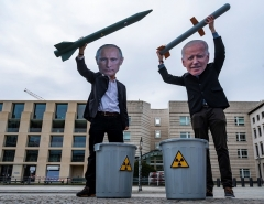 Peace activists wearing masks of Russian President Vladimir Putin and President Joe Biden pose with mock nuclear missiles in front of the US embassy in Berlin on January 29, 2021. (Photo by JOHN MACDOUGALL/AFP via Getty Images)