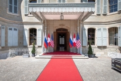 U.S. and Russian flags fly at the Villa La Grange in Geneva, the venue for Wednesday's Biden-Putin summit. (Photo by Peter Klaunzer/Pool/AFP via Getty Images)