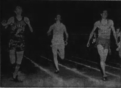 Foster Friess, on the right, running the 180-yard low hurdles for Rice Lake High School in the Eau Claire Invitational Track Meet, May 7, 1957.