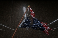 Pictured is a torn American flag amid the George Floyd protests and riots. (Photo credit: SETH HERALD/AFP via Getty Images)