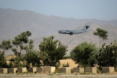 A U.S. Air Force transport plane lands at the Bagram airbase on Thursday, hours before what had been the biggest U.S. military base in Afghanistan over the past 20 years was vacated. (Photo by Wakil Kohsar/AFP via Getty Images)