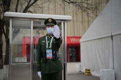 A paramilitary police officer at the entrance of at ice hockey arena in Beijing that will be used during the 2022 Winter Olympics. (Photo by Noel Celis/AFP via Getty Images)
