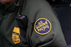 Featured is a Border Patrol agent's patch. (Photo credit: SUZANNE CORDEIRO/AFP via Getty Images)