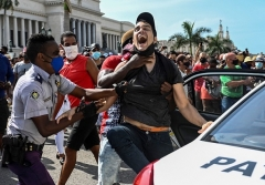 Cuban police arrest a demonstrator during Sunday's protest in Havana. (Photo by Yamil Lage/AFP via Getty Images)