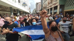 """Cuban protestors in Havana on Sunday chanted """"Freedom!"""" and """"Down with the dictatorship!"""" (Photo by Yamil Lage/AFP via Getty Images)"""