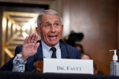 Dr. Anthony Fauci, director of the National Institute of Allergy and Infectious Diseases, responds to questions by Senator Rand Paul during the Senate Health, Education, Labor, and Pensions Committee hearing on Capitol Hill in Washington, DC on July 20, 2021. (Photo by J. SCOTT APPLEWHITE/POOL/AFP via Getty Images)