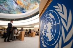 The logo of the United Nations is visible in the Human Rights Council chamber in Geneva. (Photo by Fabrice Coffrini/AFP via Getty Images)