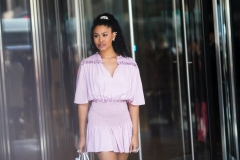Leyna Bloom wears a pink/purple ruffled and pleated dress, outside Longchamp, during New York Fashion Week Fall-Winter 2020. (Photo credit: Edward Berthelot/Getty Images)
