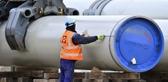 A worker on the Nord Stream 2 gas pipeline's sector in northeastern Germany. (Photo by Tobias Schwarz/AFP via Getty Images)