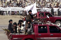 Taliban gunmen on parade in Kabul in August 2001, weeks before al-Qaeda attacked America on 9/11 attack and two months before U.S. forces toppled the regime. (Photo by Saeed Khan/AFP via Getty Images)