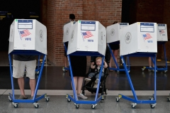 Residents vote during the New York City mayoral primary election at the Brooklyn Museum polling station. (Photo credit: ANGELA WEISS/AFP via Getty Images)
