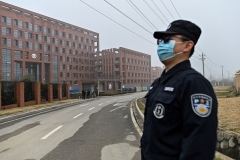 A security guard stands near the Wuhan Institute of Virology in Wuhan, a facility at the center of controversy over the theory that the coronarivus may have leaked accidentally from a lab. (Photo by Hector Retamal/AFP via Getty Images)