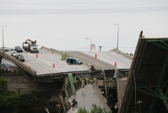This devastating I-35 bridge collapse in Minneapolis on August 4, 2007 prompted urgent calls for action on improving U.S. infrastructure. (Photo by MANDEL NGAN/AFP via Getty Images)