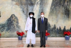 Chinese Foreign Minister Wang Yi meets with Taliban delegation head Abdul Ghani Baradar on Wednesday. (Photo: Chinese Foreign Ministry)