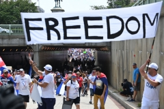 Protesters gather near the Cuban embassy during a protest in support of continued anti-government protests in Cuba in Washington DC, on July 26, 2021. (Getty Images)