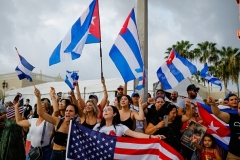 People holding Cuban and US flags protest the Cuban government in Miami, on July 12, 2021. (Photo by EVA MARIE UZCATEGUI/AFP via Getty Images)