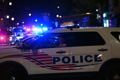 Police cars block a street after a shooting outside a restaurant in Washington, D.C., on July 22, 2021. (Photo by BRENDAN SMIALOWSKI/AFP via Getty Images)