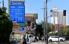 Rising gasoline prices in downtown Los Angeles as seen on June 22, 2021, one indicator of escalating inflation. (Photo by FREDERIC J. BROWN/AFP via Getty Images)