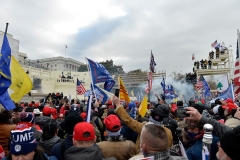 Supporters of President Donald Trump clash with police and security forces at the Capitol on January 6, 2021. (Photo by JOSEPH PREZIOSO/AFP via Getty Images)