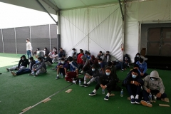 Minors who tested positive for COVID-19 are seen at the Donna holding facility, the main detention center for unaccompanied children in the Rio Grande Valley run by the US Customs and Border Protection, in Donna, Texas on March 30, 2021. (Photo by DARIO LOPEZ-MILLS/POOL/AFP via Getty Images)
