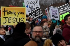 """Pro-life demonstrators take part in the 47th annual """"March for Life"""" in Washington on January 24, 2020. (Photo by OLIVIER DOULIERY/AFP via Getty Images)"""