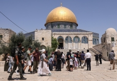 With the Dome in the Rock mosque in the background, Jewish visitors enter the Temple Mount compound in Jerusalem on Sunday, a fasting day marking the destruction of ancient Jewish temples. (Photo by Ahmad Gharabli/AFP via Getty Images)
