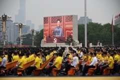 Chinese President Xi Jinping, on screen, delivers a speech during the celebrations of the 100th anniversary of the founding of the CCP on Thursday. (Photo by Wang Zhao/AFP via Getty Images)