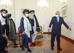 Iranian foreign minister Javad Zarif welcomes a senior Taliban delegation on a previous visit to Tehran, last January. (Photo by -/Tasnim News/AFP via Getty Images)