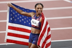 Bronze medalist Allyson Felix of Team USA celebrates after competing in the Women's 400m. (Photo credit: Fred Lee/Getty Images)